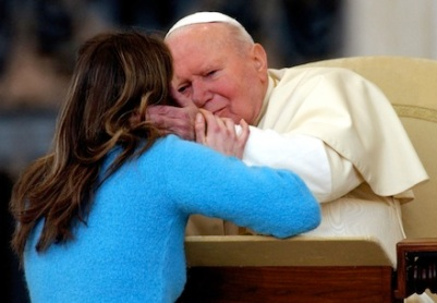 YOUNG POLISH WOMAN EMBRACES POPE JOHN PAUL II