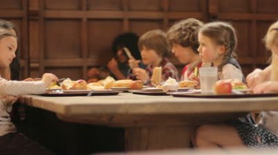 stock-footage-school-food-a-group-of-elementary-school-children-eating-a-school-lunch